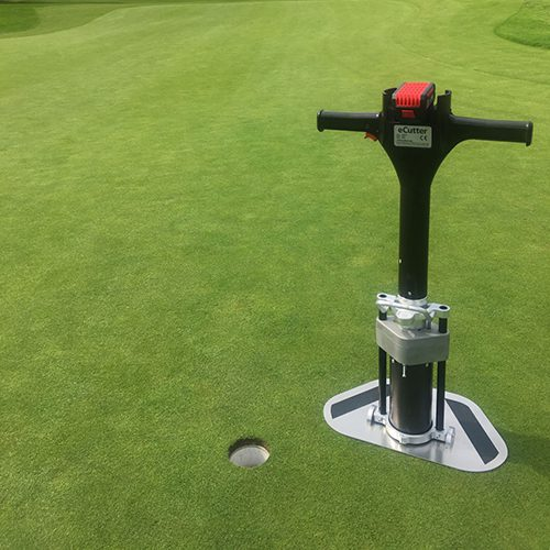 Golf Machine's electric eCutter on golf green after cutting a hole